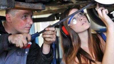Apprentice working in a garage